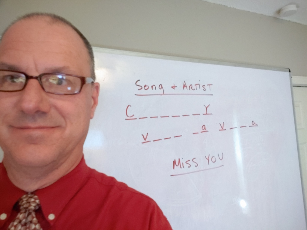 Teacher with white board behind him