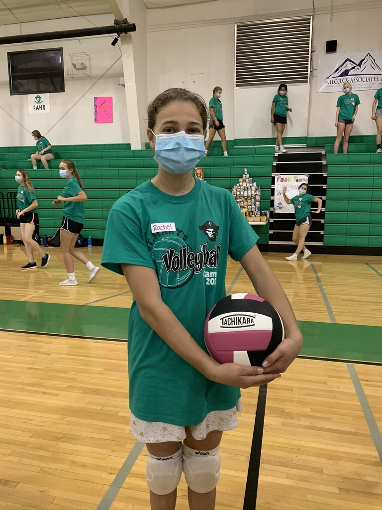 Volleyball camper with a ball and wearing a mask